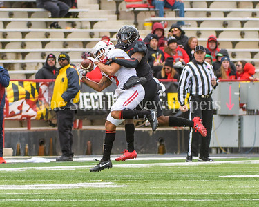 Terps linebacker  Jermaine Carter, Jr works Rutger's wide receiver Juwan Harris as Harris reeels in a pass.