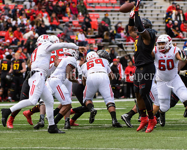 Terp defensive lineman Cavon Walker goes up to block a Rutgers QB pass by Sophomore Giovanni Rescigno.