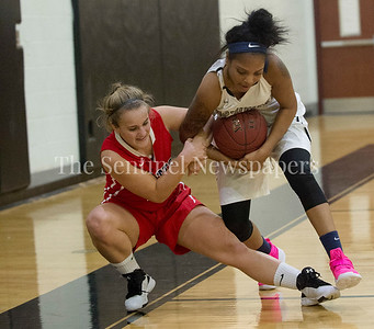 Wootton High School Shannon Welty (34), and Northwest NadiaWhitaker (5), fight for the ball. 12 06 2016 Opening Girls Basketball game. Northwest High School v Wootton High School.