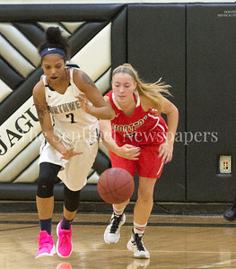 MariahEllis (2), Wootton High School Zoey Goldberg (5) 12 06 2016 Opening Girls Basketball game. Northwest High School v Wootton High School.