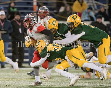 Dragging three Damascus players, Franklin running back Justin Spence adance the ball.