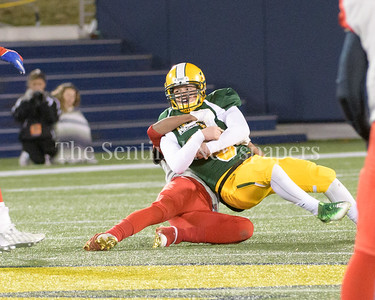 Damascus backup quaterback John Allen Furgeson gets sacked.