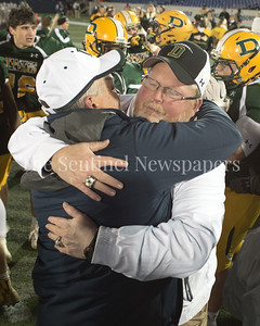 The Damascus Coaches congratulate one another on winning the State Championship for division 3A.