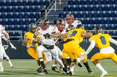 12/9/2016 - QO quarterback Doc Bonner's (10) gets through the line of scrimmage in the Maryland 4A Championship game between Quince Orchard and Wise, ©2016 Jacqui South Photography