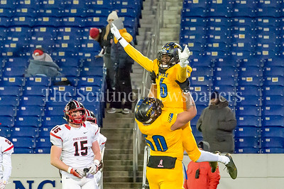 12/9/2016 - Chase Savion Williams (50) raises Kryree Jackson (6) after scoring a touchdown in the Maryland 4A Championship game between Quince Orchard and Wise, ©2016 Jacqui South Photography