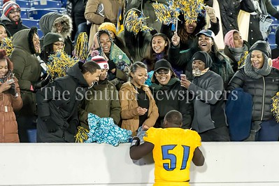 12/9/2016 - Robert Burwell II celebrates with fans and family after the Maryland 4A Championship game between Quince Orchard and Wise, ©2016 Jacqui South Photography