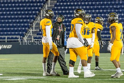 12/9/2016 - Coach Dalawn Parrish asks Malcolm Sumler (9) how QO was able to score a touchdown during the Maryland 4A Championship game between Quince Orchard and Wise, ©2016 Jacqui South Photography