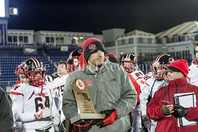 12/9/2016 - Quince Orchard Head Coach John Kelley with the State Finalst trophy after the Maryland 4A Championship game between Quince Orchard and Wise, ©2016 Jacqui South Photography