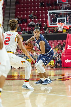 12/10/2016 - Nick Griffin (Magruder High School) with the ball being guarded by Melo Trimble (2) St. Peter's v University of Maryland Basketball game at the Xfinity Center, ©2016 Jacqui South Photography
