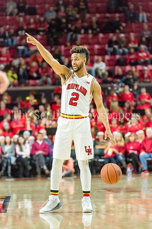 12/10/2016 - Melo Trimble directing the offense in the St. Peter's v University of Maryland Basketball game, ©2016 Jacqui South Photography
