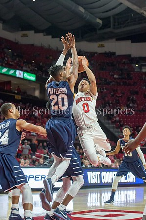 12/10/2016 - Chazz Patterson (20) gets both hands up as Anthony Cowan (0) shoots a layup in the St. Peter's v University of Maryland Basketball game, ©2016 Jacqui South Photography