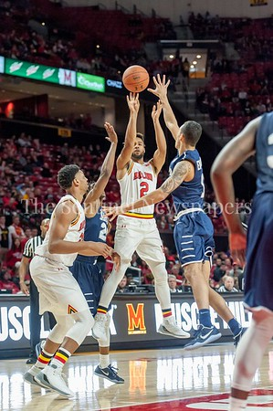 12/10/2016 - Melo Trimble (2) shoots over Nnamdi Enechionyia (11) in the St. Peter's v University of Maryland Basketball game, ©2016 Jacqui South Photography