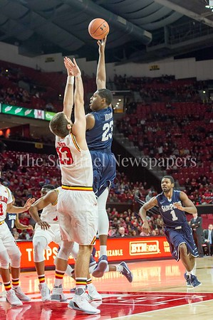 12/10/2016 - Samuel Idowi (23) with a hook shot for St. Peter's over University of Maryland defender Ivan Bender (13), ©2016 Jacqui South Photography