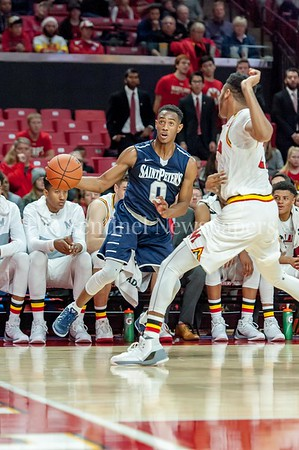 12/10/2016 - Nick Griffin (Magruder High School) guarded by Jared Nickens  in the St. Peter's v University of Maryland Basketball game at the Xfinity Center, ©2016 Jacqui South Photography