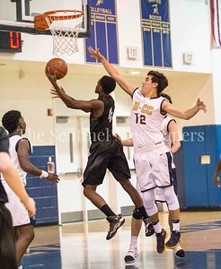 James Assiongbon (4), Bethesda-Chevy Chase Barons Thomas Baer (12), 12 16 2016 Northwest High School travels to Bethesda-Chevy Chase - Boys Varsity Basketball