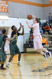 Rockville's Matthew McTighe launches himself towards the hoop.