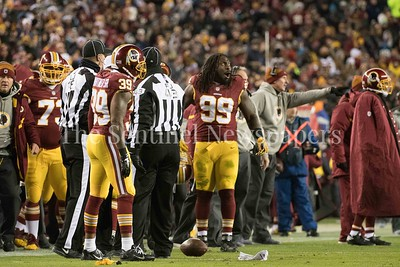 Ricky Jean Francois (99) reacts to a late hit call which wsa later overturned.