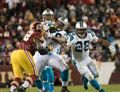 Chris Baker puts presssure on the line protecting Cam Newton.