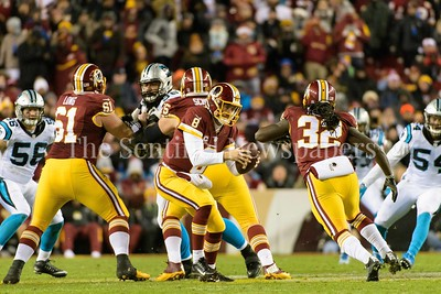 Kirk Cousins fakes a hand off to Robert Kelley.