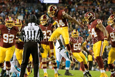Josh Norman leaps to celebrate busting a pass play from Cam Newton.
