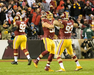 Ryan Kerrigan and Trent Murphy along with CHris Baker in the background, celebrate holding off a touchdown by  the Panthers on 3rd and goal to force field goal attempt.