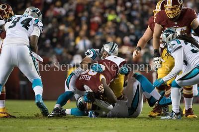Robert Kelley gets folded like a pretzel when stopped for a 1 yard gain.