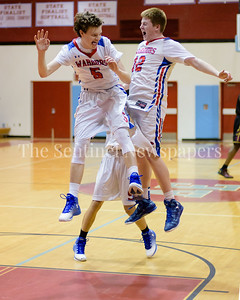 Sherwood PLayers Domenico Martella and Kevin Russell celebrate winning the Brad Pinchback Holiday Tournament by defeating Bladensburg High School.
