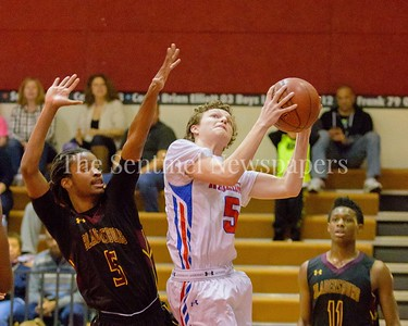 Domenico Martella fo Sherwood bulls himself over Bladensburg's Lindsay for two points.