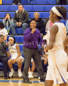 Coach McDaniel offers encounragement from the team bench to his Lady Trojans of Gaithersburg.
