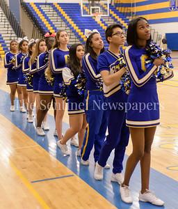 The Gaithersburg Trojan cheerleaders during the National Anthem.