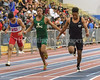 At the finish line, first place Josh Netterville, (right) Northwest High School 6.44  <br /> 2nd Christopher Frederick (left) Gar-Field 6.53  Raynard Bell  (middle)               John F. Kennedy 6.55