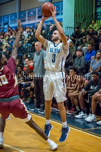 1/5/2018 - Springbrook guard Sam Rafidi (3) shoots a 3 point shot, ©2018 Jacqui South Photography