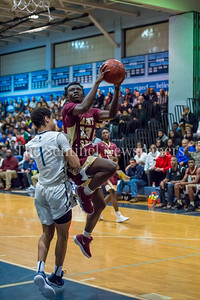 1/5/2018 - Paint Branch Chris Makaya (23) shoots a layup over Springbrook defender Matthew Balanc (1) , ©2018 Jacqui South Photography