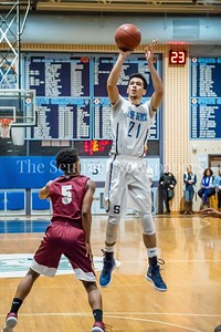 1/5/2018 -Springbrook forward Cameron Rucker (21) shoots from the top of the key for the Blue Devils, ©2018 Jacqui South Photography