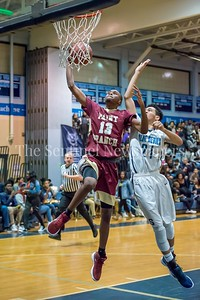 1/5/2018 -Xavier Reaves (13) is fouled by Cameron Rucker (21) on this fast break layup , ©2018 Jacqui South Photography