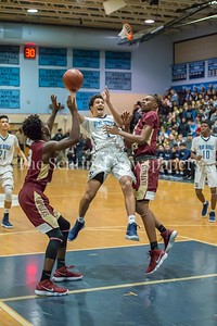 1/5/2018 - Springbrook guard Matthew Balanc (1) shoots a fade-away shot in the lane between Paint Branch defenders Mishel Etuaful (3) & Xavier Reaves (13), ©2018 Jacqui South Photography