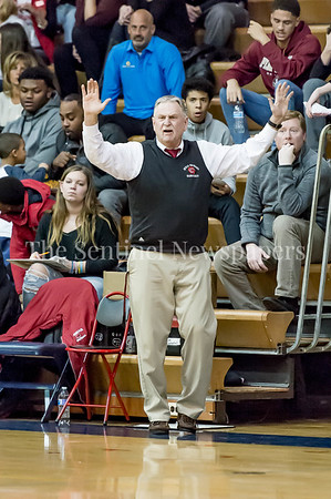 1/5/2017 - Quince Orchard Head Coach Paul Foringer showing hands up defense, ©2016 Jacqui South Photography