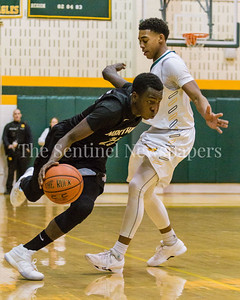 Adrian Thomas of Northwest blows around Tyran Crawford