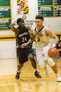 Brandon Simpson from Seneca Valley drives past guard Nick  Yankum a junior at Northwest High School.