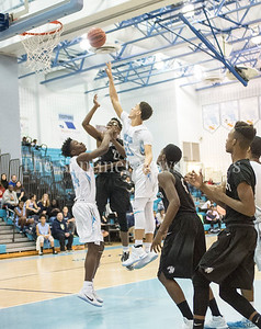 Clarksburg High School forward Cornell Hanna (24), Northwest High School Jaguars Lameek Lumsden (22)