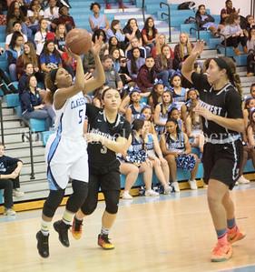 Clarksburg High School #5 Miya Mozie (C) (5), Northwest High School forward Laurel Cotton (3), Northwest High School Alexis Mack (1)