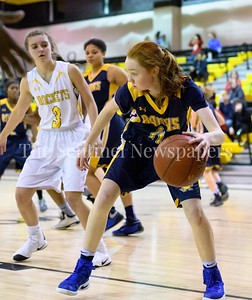Charlotte Lowndes from BCC guards her position looking for a route to the other end of the floor.