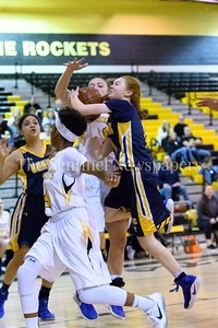 Fighting to get her shot off, BCC's Charlotte Lowndes double coverage by Richard Mongomery Rockets.
