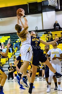 Melanie Osborne of Richard Montgomery and Caitlyn Clendenin battle for a rebound in the 3rd period of the game.