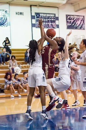 1/19/2017 - Paint Branch's Amele Ngwafang (35) powers her way into the lane knocking down Magruder's Maddie Jennings (24) and is fouled by Dyamond Blackman (12), ©2017 Jacqui South Photography