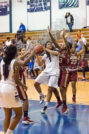 1/19/2017 - Magruder guard Laila Grant (5) drives in the lane guarded by Paint Branch Alex Glover (13), ©2017 Jacqui South Photography