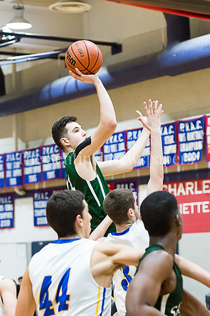 1/26/2017 - Sandy Spring Friend's Milos Apic (44) rises above all other players on this one handed floater, ©2017 Jacqui South Photography