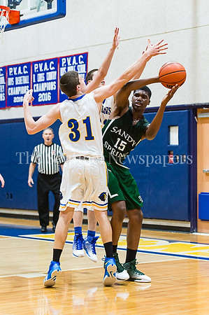 1/26/2017 - Sandy Spring Friends Chiedu Nduka-eze is double teamed by Jewish Day defenders Daniel Zweben (31) and Nadav Kalender (33), ©2017 Jacqui South Photography