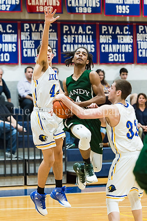 1/26/2017 - Nadav Kalender (33) grabs the ball as Sandy Spring Friends guard Mike Young (4) goes up for a layup, jump ball is called, ©2017 Jacqui South Photography