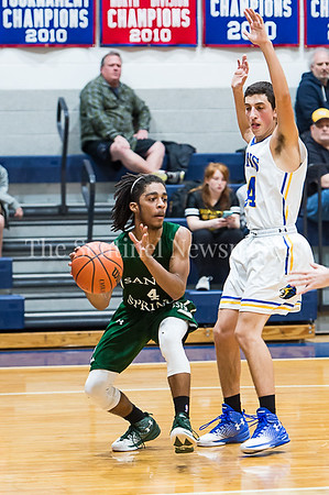 1/26/2017 - Sandy Spring Friends guard Mike Young (4) looks to bounce pass into the lane, ©2017 Jacqui South Photography